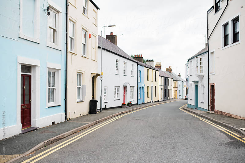 colorful houses in street in Wales by Léa Jones for Stocksy United