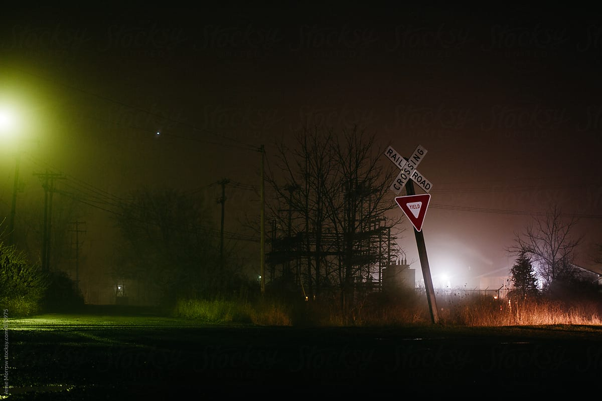 Stock Photo - Railroad Crossing At Night In Fog