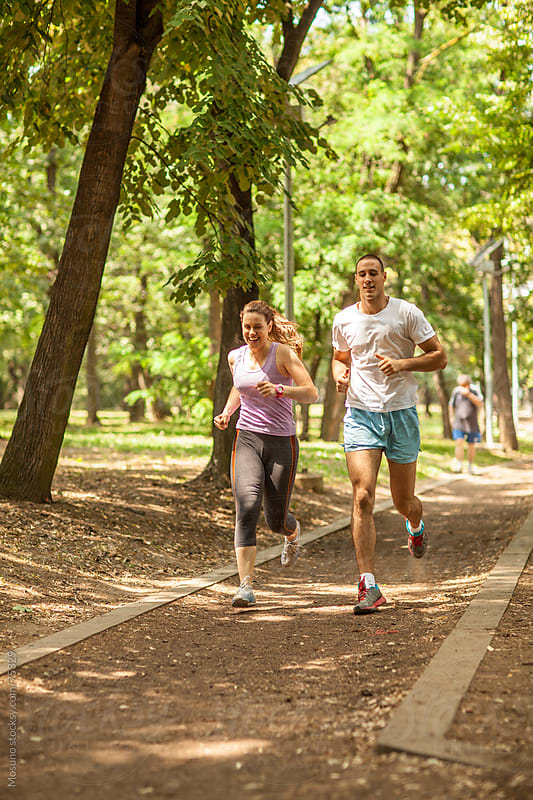 Friends Jogging in the Park by Mosuno for Stocksy United