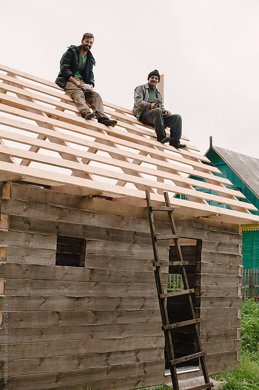 Men building wooden house by Milles Studio for Stocksy United