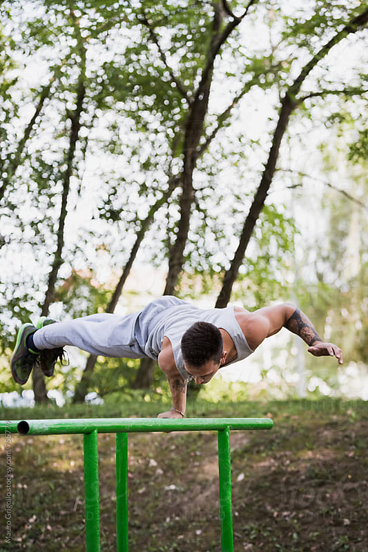Man doing strong workout at the park by Mauro Grigollo for Stocksy United