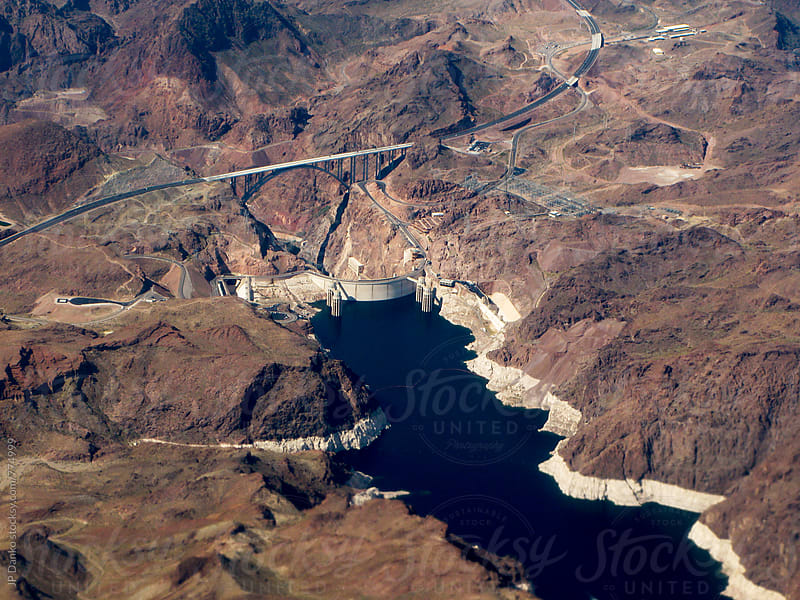Aerial Photo of Hoover Dam and Lake Mead On Approach To Las Vegas Airport from Commercial Flight by JP Danko for Stocksy United