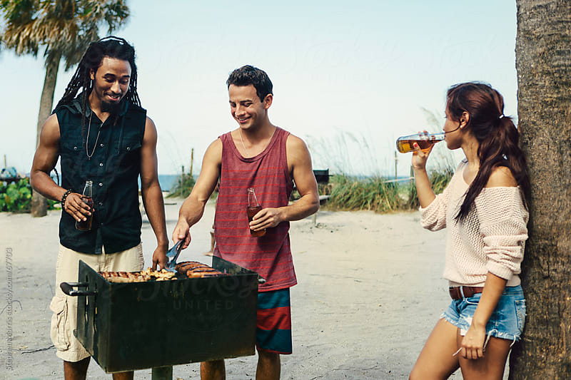 Friends Grilling at the Beach by Stephen Morris for Stocksy United