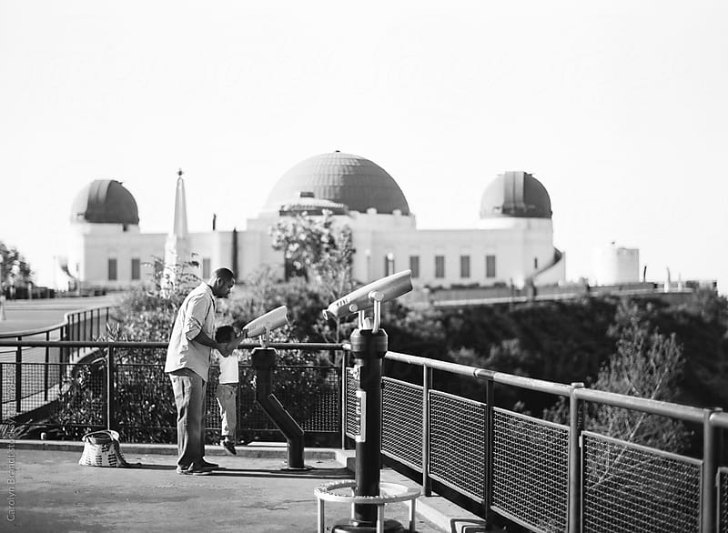 father and son at the observatory by Carolyn Brandt for Stocksy United