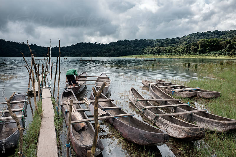 Canoes on Lake Tamblingan, Bali by Gary Radler Photography for Stocksy United