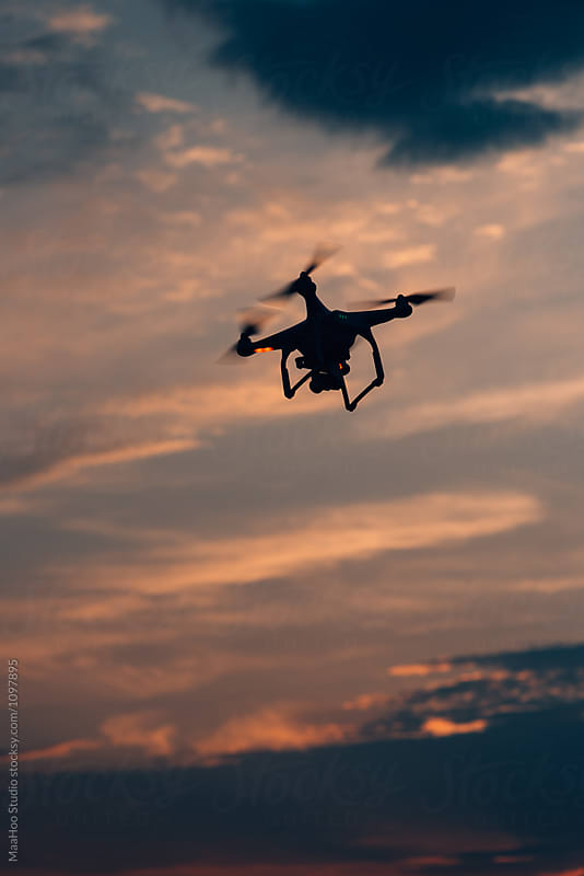 Aerial drone flying against clouds by Maa Hoo for Stocksy United