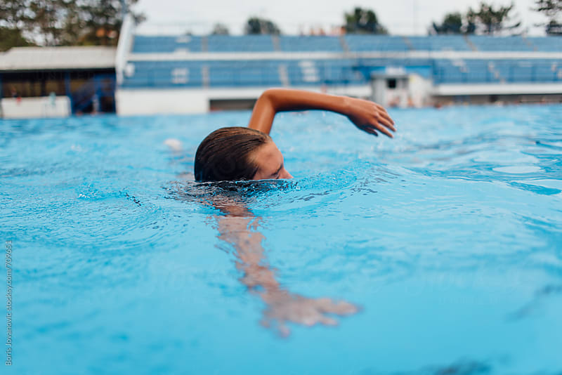 Young boy having fun in the swimming pool  by Boris Jovanovic for Stocksy United