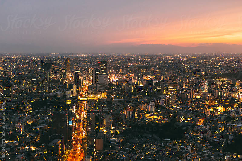 Tokyo skyline at sunset. by BONNINSTUDIO for Stocksy United