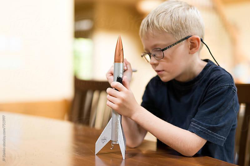 Little Boy Rocket Scientist WIth Home Made Model Rocket Ready for Flight by JP Danko for Stocksy United