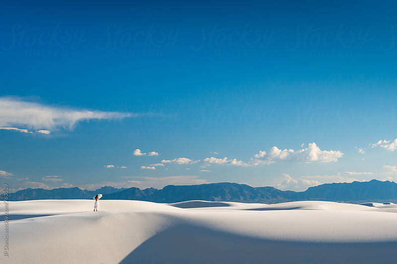 Woman With Vibrant Blue Sky and White Sand Dunes In White Sands National Monumant New Mexico by JP Danko for Stocksy United