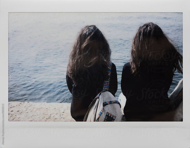 two young woman enjoying the summer time near the sea .  by Alexey Kuzma for Stocksy United