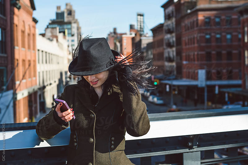 Pretty young woman takes a selfie in New York City by GIC for Stocksy United
