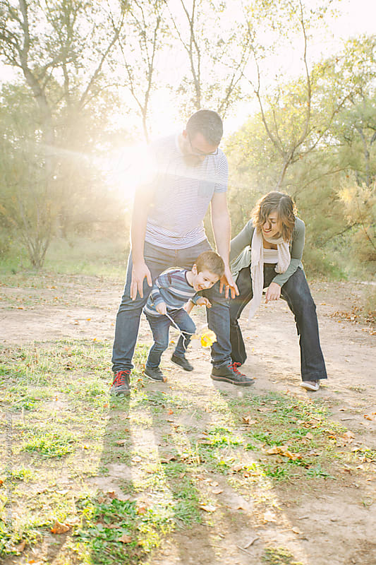 Family playing outdoors  by Blai Baules for Stocksy United