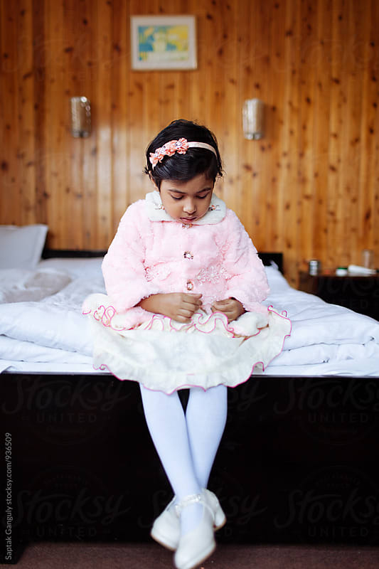 Little girl sitting in a pensive mood by Saptak Ganguly for Stocksy United