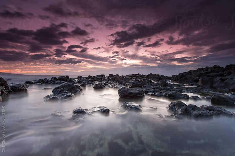 Colorful sunset over Maui by Chris Chabot for Stocksy United