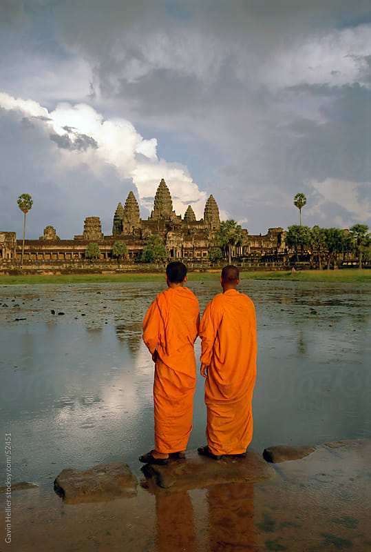 Buddhist monks in front of Angkor Wat, Angkor, UNESCO World Heritage Site, Siem Reap, Cambodia by Gavin Hellier for Stocksy United