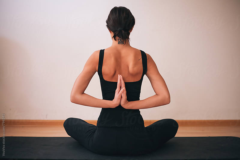Woman doing yoga indoor by VeaVea for Stocksy United
