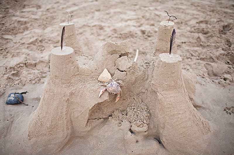 A large sandcastle built on beach in summer by Natalie JEFFCOTT for Stocksy United
