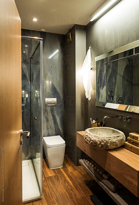 Modern bathroom with sink made of stone by Aleksandar Novoselski for Stocksy United