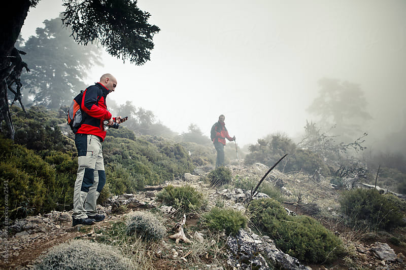 Hiker Using Smart Phone Outdoors by Stephen Morris for Stocksy United