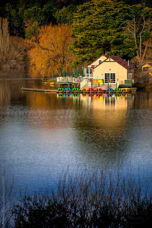 Sunny Boathouse on Naural Lake with Reflection by Rowena Naylor for Stocksy United