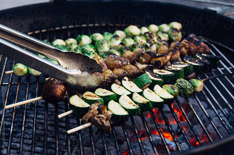Vegetable skewers on a charcoal grill by Gabriel (Gabi) Bucataru for Stocksy United