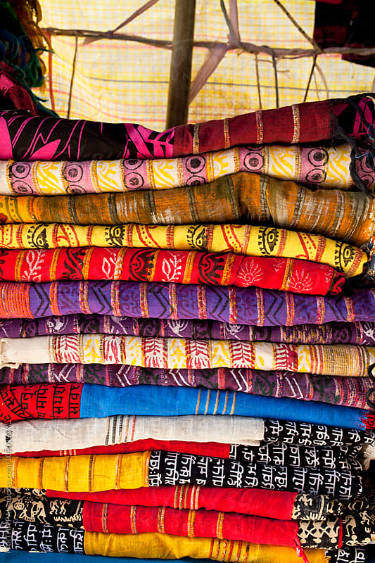 Colorful Traditional Indian Dress material on sell in a shop by PARTHA PAL for Stocksy United