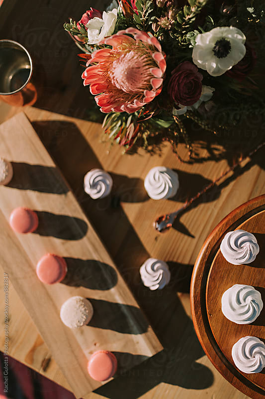 Macaron and Meringue Desserts on Table by Rachel Gulotta Photography for Stocksy United