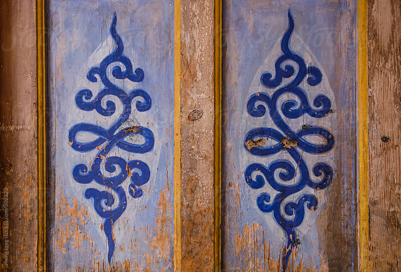 The decorative pattern on the Lama Temple door by zheng long for Stocksy United