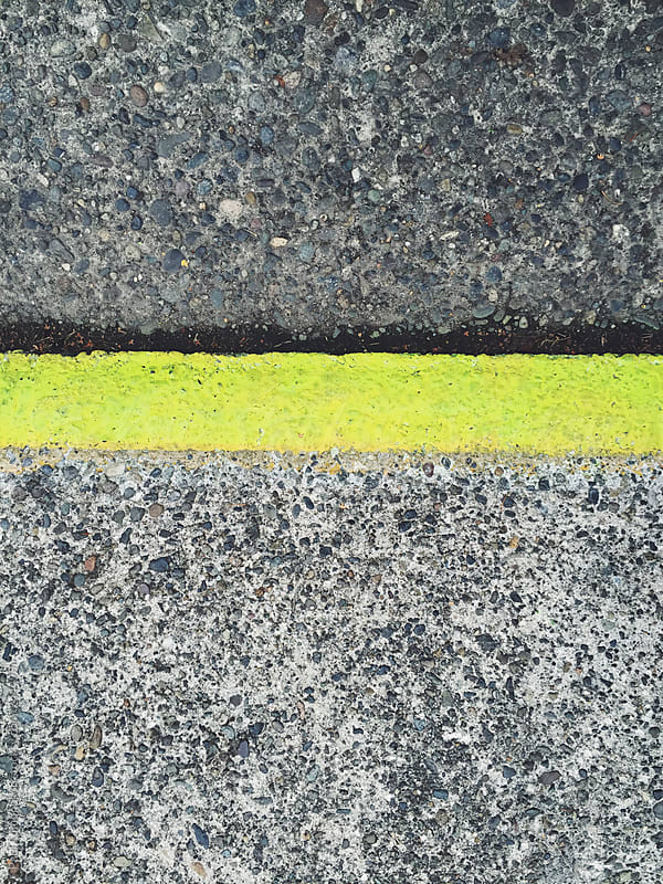 Painted yellow curb along sidewalk and street, close up by Paul Edmondson for Stocksy United