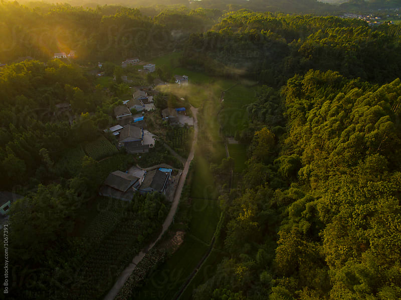 aerial view of small village at sunset by cuiyan Liu for Stocksy United