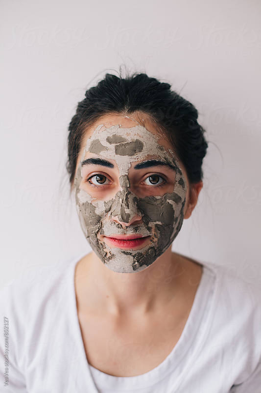 Portrait of a beautiful brunette woman with cosmetic facial mask by VeaVea for Stocksy United