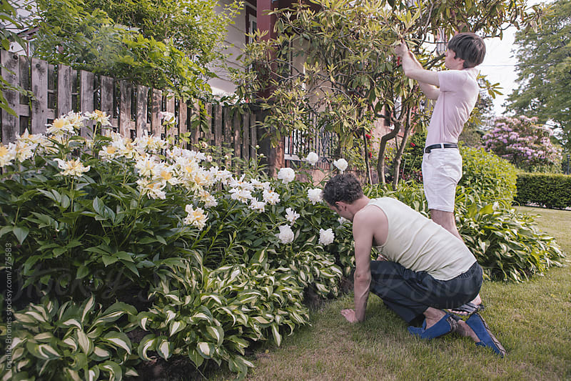 Married Gay Couple at Home Gardening in their Front Lawn by Joselito Briones for Stocksy United