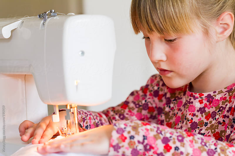 Girl sewing on machine by Kirsty Begg for Stocksy United