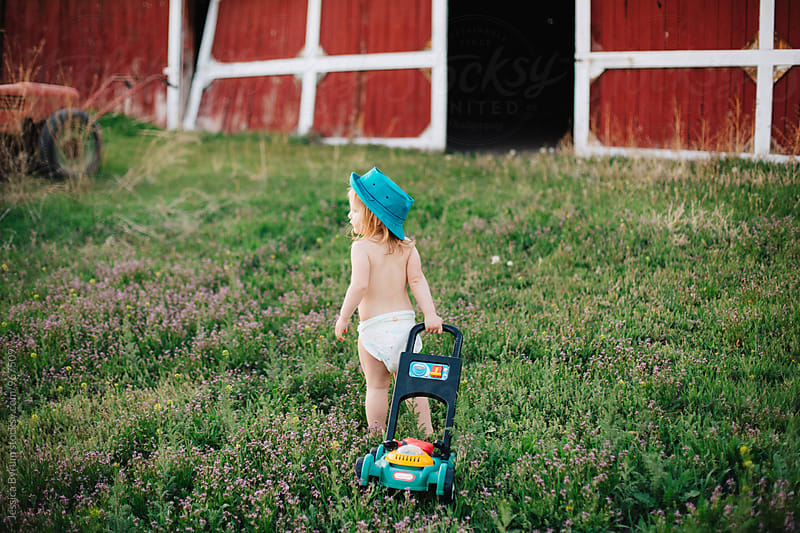 So much to mow by Jessica Byrum for Stocksy United