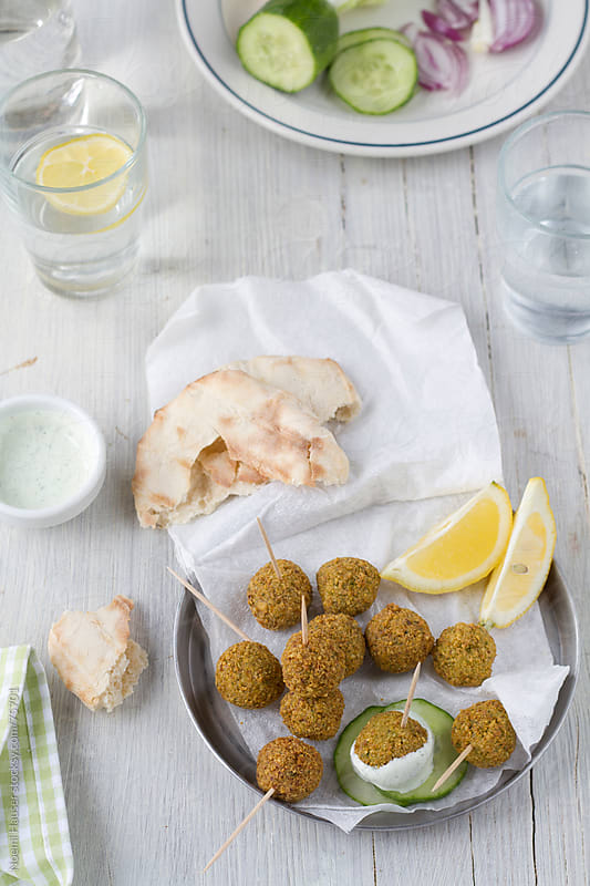 Falafel with pita and cucumber by Noemi Hauser for Stocksy United