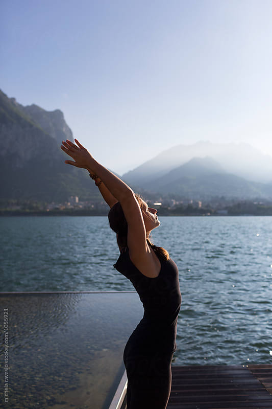 Woman doing yoga pose: Urdhva Hastasana by michela ravasio for Stocksy United
