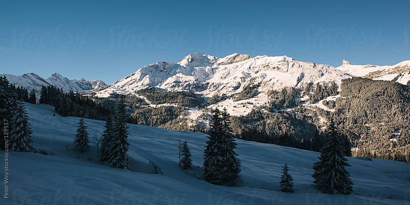Panorama of Mürren and Schildhorn mountain peak by Peter Wey for Stocksy United