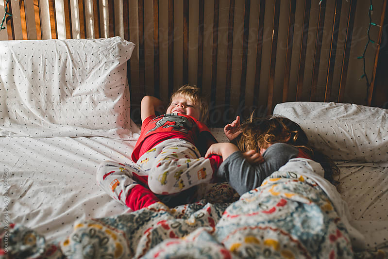 Waking up in mama's bed by Courtney Rust for Stocksy United
