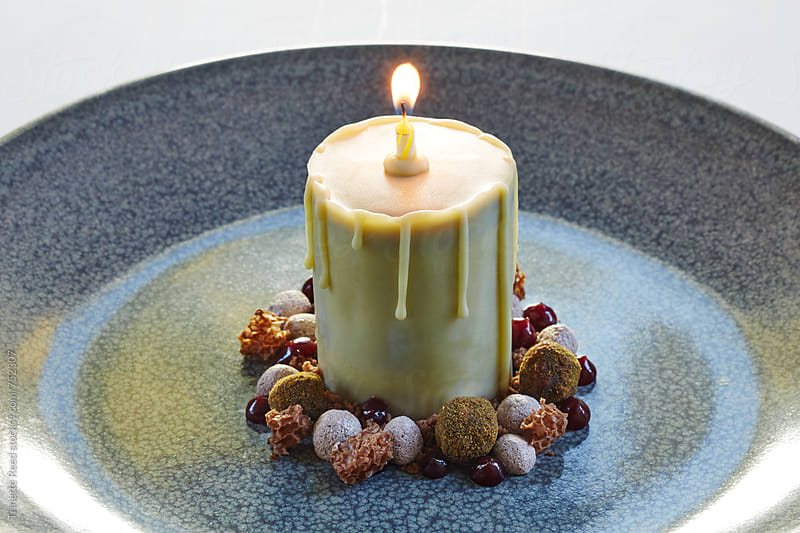 Dark chocolate and Caramel Candle Cake  by Trinette Reed for Stocksy United