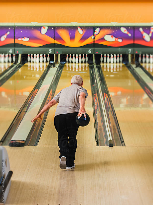 Bowling: Mature Male Bowler About To Bowl A Strike by Sean Locke for Stocksy United