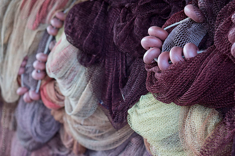 Backgrounds: Fishing nets in different colors by Ina Peters for Stocksy United