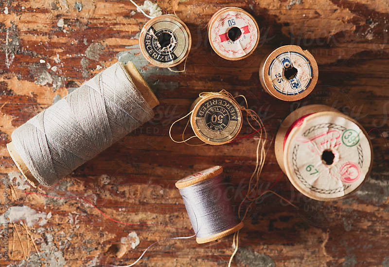 Assorted vintage spools of thread by Kristin Duvall for Stocksy United