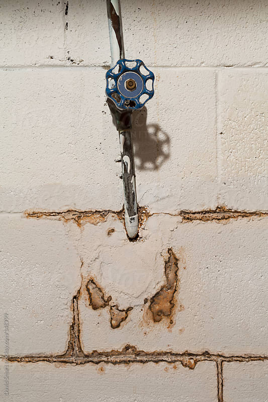 Block wall with water stains from a leaking valve by David Smart for Stocksy United