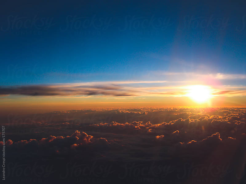 Aerial view from airplane, clouds and sunset scene by Leandro Crespi for Stocksy United