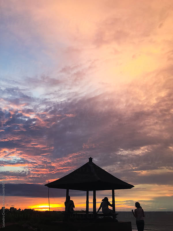 A beautiful pink sunset in an Indonesian beach by Leandro Crespi for Stocksy United