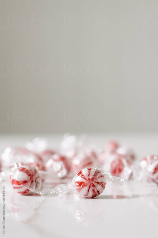 red and white striped christmas candy, a little bit retro by Gillian Vann for Stocksy United