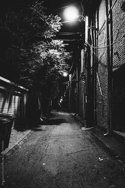 empty urban alley - vertical by Margaret Vincent for Stocksy United