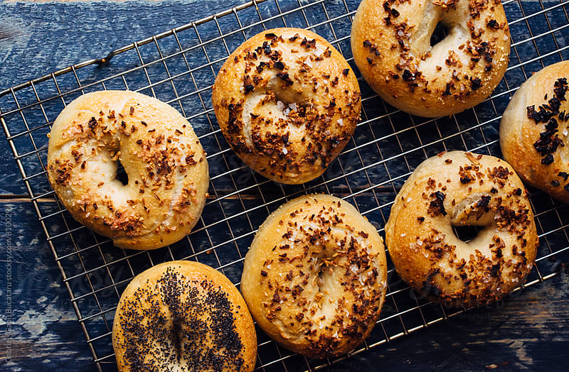 Freshly baked bagels from overhead by Gabriel (Gabi) Bucataru for Stocksy United