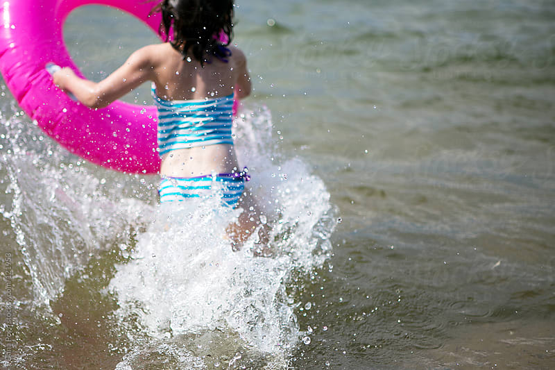 summer swim by Dana Pugh for Stocksy United